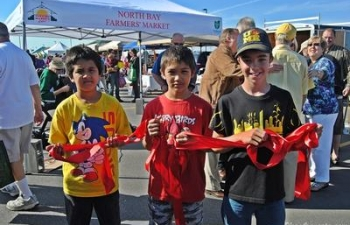 Corey.Drake.Ethan.ribbon.holders.opening.day.NBFM.2013
